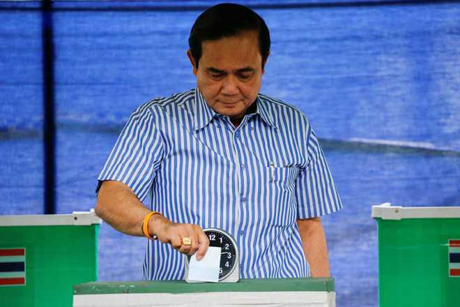 Thai Prime Minister Prayuth Chan-ocha casts his ballot at a polling station during a constitutional referendum vote in Bangkok