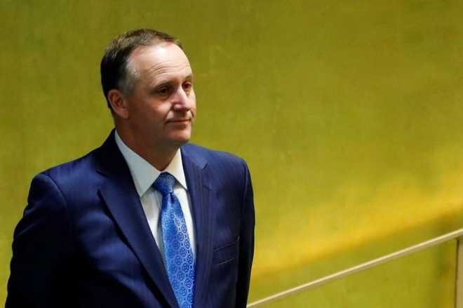 New Zealand's Prime Minister Key enters the General Assembly Hall to speak during the 71st United Nations General Assembly in Manhattan, New York